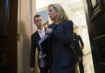 FILE - In this Aug. 16, 2018, file photo, Homeland Security Secretary Kirstjen Nielsen, foreground, talks with Max Schachter, left, father of Alex Schachter, who was killed during the Marjory Stoneman Douglas High School shooting, as they arrive for a meeting of the Federal Commission on School Safety in the Indian Treaty Room of the Eisenhower Executive Office Building in Washington.
