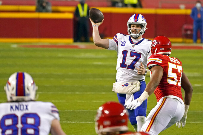 Buffalo Bills quarterback Josh Allen (17) throws a pass as he is pressured by Kansas City Chiefs defensive end Alex Okafor (57) during the first half of the AFC championship NFL football game, Sunday, Jan. 24, 2021, in Kansas City, Mo. (AP Photo/Charlie Riedel)