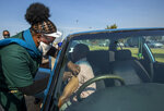 Health workers vaccinates a pensioner with a first dose of the Pfizer coronavirus vaccine at the newly-opened mass vaccination program for the elderly at a drive-thru vaccination center in Johannesburg, South Africa, Tuesday, May 25, 2021. (AP Photo/Themba Hadebe)