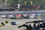 A.J. Allemdinger leads the field in overtime to win the NASCAR Xfinity Cup Series auto race at Michigan International Speedway, Saturday, Aug. 21, 2021, in Brooklyn, Mich. (AP Photo/Carlos Osorio)