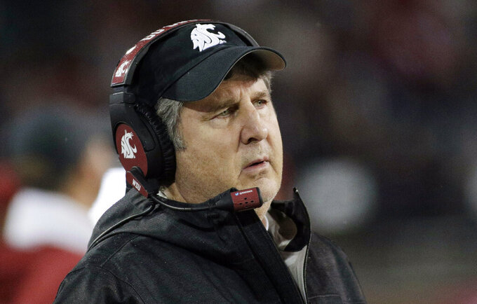 FILE - In this Nov. 3, 2018, file photo, Washington State head coach Mike Leach watches during the second half of an NCAA college football game against California in Pullman, Wash. Washington State and Leach have agreed on a one-year contract extension that runs through the 2023 season, the school said, Wednesday, Jan. 30, 2019. (AP Photo/Young Kwak, File)