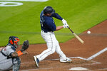 Seattle Mariners' Ty France doubles in a run against the Houston Astros in the seventh inning of a baseball game Monday, Sept. 21, 2020, in Seattle. (AP Photo/Elaine Thompson)
