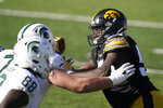 Iowa defensive tackle Daviyon Nixon, right, rushes up field during the second half of an NCAA college football game against Michigan State, Saturday, Nov. 7, 2020, in Iowa City, Iowa. Nixon was selected to The Associated Press All-America first-team defense, Monday, Dec. 28, 2020. (AP Photo/Charlie Neibergall)