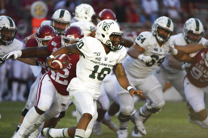Portland State quarterback Jalani Eason runs the ball against Arkansas during the second half of an NCAA college football game Saturday, Aug. 31, 2019 in Fayetteville, Ark. (AP Photo/Michael Woods)