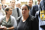 Elif Kubasik, wife of NSU victim Mehmet Kubasik, arrives outside the court in Munich, southern Germany, prior to the verdict Wednesday, July 11, 2018 before  a court in Munich is due to conclude its five-year trial of the only known survivor of a far-right cell NSU suspected of killing nine people from ethnic minorities and a police officer, in a case that shocked Germany when it came to light in 2011. (Tobias Hase/dpa via AP)