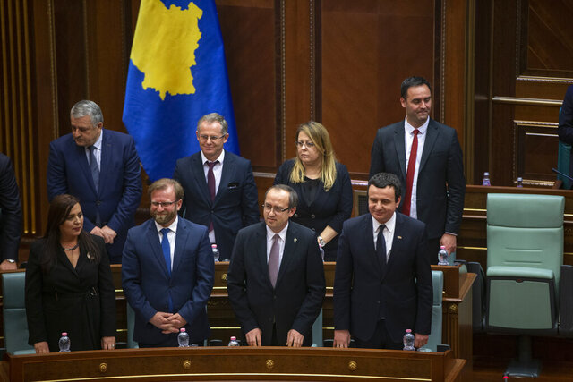 Albin Kurti, 1st row from right, the newly elected prime minister of Kosovo presents his ministers as the new government was elected in the capital Pristina, Monday, Feb. 3, 2020.  Kosovo's parliament convened on Monday to vote in a new prime minister after four months of talks between the country's two main parties. (AP Photo/Visar Kryeziu)