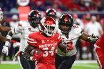 Houston running back Mulbah Car (34) runs the ball against Texas Tech during the second half of an NCAA college football game Saturday, Sept. 4, 2021, in Houston. (AP Photo/Justin Rex)