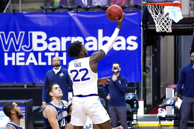 Seton Hall guard Myles Cale (22) goes to the basket past Villanova forward Cole Swider (10) during the first half of an NCAA college basketball game, Saturday, Jan. 30, 2021, in Newark, N.J. (AP Photo/Mary Altaffer)