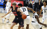 Utah center Jayce Johnson, left, and Colorado forward Evan Battey, center, and guard McKinley Wright IV look for the ball during the first half of an NCAA college basketball game Saturday, March 2, 2019, in Boulder, Colo. (AP Photo/David Zalubowski)