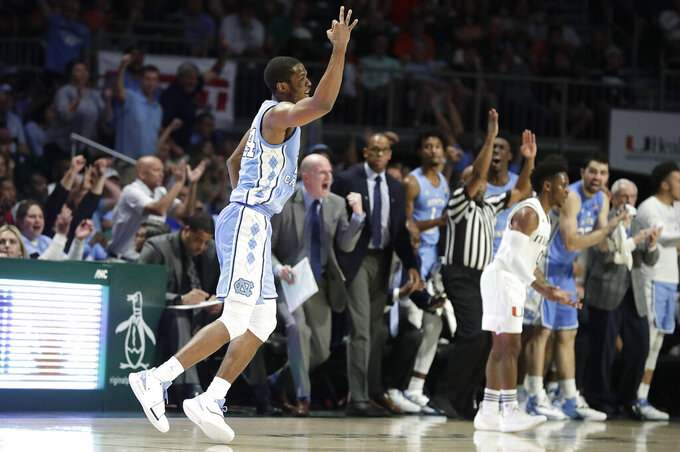 North Carolina guard Kenny Williams gestures after scoring a 3-point basket during the second half of an NCAA college basketball game against Miami on Saturday, Jan. 19, 2019, in Coral Gables, Fla. (AP Photo/Brynn Anderson)