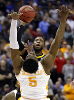 Iowa's Isaiah Moss, top, shoots over Tennessee's Admiral Schofield in the second half during a second-round men's college basketball game in the NCAA Tournament in Columbus, Ohio, Sunday, March 24, 2019. (AP Photo/Tony Dejak)