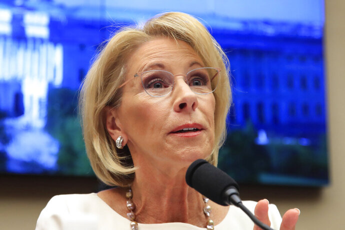 FILE - In this April 10, 2019, file photo, Education Secretary Betsy DeVos testifies on Capitol Hill in Washington. An internal Education Department watchdog says DeVos has sometimes used personal email accounts for government business and did not always properly save the messages. The agency's Office of Inspector General released a report Monday, May 20, finding