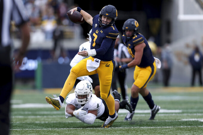 California quarterback Chase Garbers runs against Sacramento State linebacker Taylor Powell (4) during the second half of an NCAA college football game on Saturday, Sept. 18, 2021, in Berkeley, Calif. (AP Photo/Jed Jacobsohn)