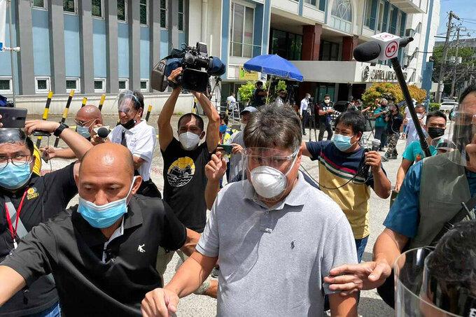 "Former senator Francis ""Kiko"" Pangilinan, center, leaves Capitol Medical Center  where former Philippine President Benigno Aquino III was transported in Quezon city, Philippines Thursday, June 24, 2021.  (AP Photo/Joeal Calupitan)"
