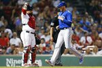 Toronto Blue Jays' Justin Smoak, right, scores on a single by Danny Jansen as Boston Red Sox's Sandy Leon, left, looks on during the eighth inning of a baseball game in Boston, Monday, July 15, 2019. (AP Photo/Michael Dwyer)