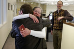 Pittsburgh Post Gazette City Editor Lillian Thomas, center, hugs reporter Andrew Goldstein in the paper's downtown Pittsburgh newsroom after it was announced that the paper's staff coverage of the shooting at the Tree of Life Synagogue last October was awarded the Pulitzer Prize for Breaking News Reporting, Monday, April 15, 2019. (AP Photo/Gene J. Puskar)