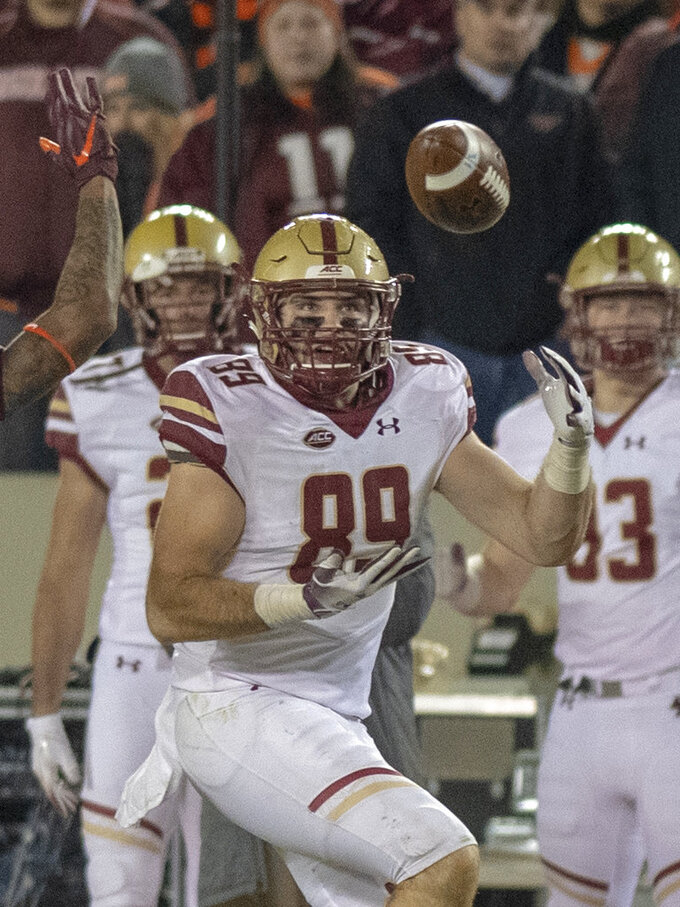 Boston College tight end Tommy Sweeney completes a catch during an NCAA college football game against Virginia Tech in Blacksburg, Va., Saturday, Nov. 3, 2018. (AP Photo/Matt Bell)