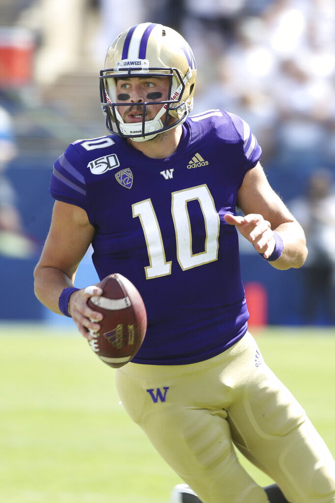 Washington quarterback Jacob Eason (10) looks to pass the ball during the first half of an NCAA college football game against BYU, Saturday, Sept. 21, 2019, in Provo, Utah. (AP Photo/George Frey)