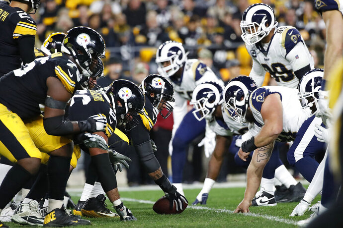 FILE - In this Nov. 10, 2019, file photo, the Pittsburgh Steelers offense, left, lines up against the Los Angeles Rams' defense during the first half of an NFL football game in Pittsburgh. The NFL's decision to expand the playoffs from 12 to 14 teams this season could have a major impact on the league based on how things have played out in the past.(AP Photo/Don Wright, File)