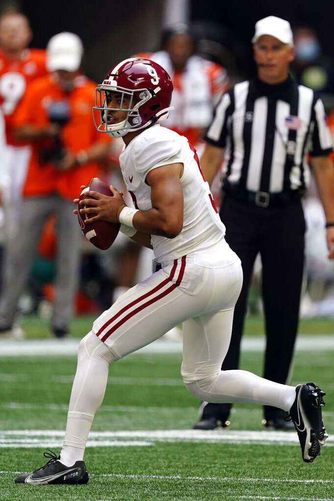 Alabama quarterback Bryce Young (9) throws on the run during the second half of an NCAA college football game against Miami, Saturday, Sept. 4, 2021, in Atlanta. (AP Photo/John Bazemore)
