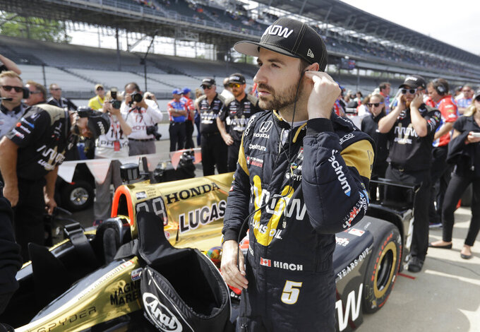 FILE - In this May 20, 2017, file photo, James Hinchcliffe, of Canada, waits for the start of qualifications for the Indianapolis 500 IndyCar auto race at Indianapolis Motor Speedway in Indianapolis. If Hinchcliffe has learned anything about Indianapolis Motor Speedway over the last eight years, it's how exhilarating and cruel this track can be to drivers. (AP Photo/Darron Cummings, File)