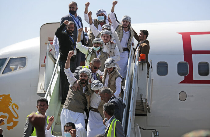 Yemeni prisoners chant slogans during their arrival after being released by the Saudi-led coalition at the airport in Sanaa, Yemen, Thursday, Oct. 15, 2020. (AP Photo/Hani Mohammed)