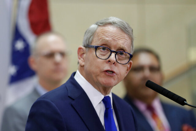 FILE - In this Feb. 27, 2020, file photo Ohio Gov. Mike DeWine gives an update at MetroHealth Medical Center in Cleveland on the state's preparedness and education efforts to limit the potential spread of the coronavirus. On Friday, Oct. 23 DeWine and the leaders of the House and Senate announced $429 million in aid to individuals and businesses struggling from the economic strain of the coronavirus. The money includes grants to bars and restaurants, help for low-income renters, assistance for arts and nonprofit organizations, and aid for colleges and universities. (AP Photo/Tony Dejak, File)