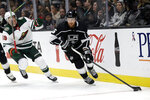 Los Angeles Kings' Joakim Ryan (6) skates past Minnesota Wild's Victor Rask (49) during the first period of an NHL hockey game Tuesday, Nov. 12, 2019, in Los Angeles. (AP Photo/Marcio Jose Sanchez)