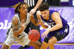 Chicago State guard Rajeir Jones, left, and Northwestern guard Ty Berry battle for a loose ball during the first half of an NCAA college basketball game in Evanston, Ill., Saturday, Dec. 5, 2020. (AP Photo/Nam Y. Huh)