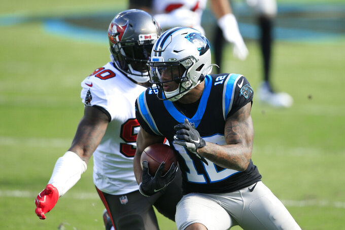 Carolina Panthers wide receiver D.J. Moore (12) runs for the end zone for a touchdown against Tampa Bay Buccaneers outside linebacker Jason Pierre-Paul (90) during the first half of an NFL football game, Sunday, Nov. 15, 2020, in Charlotte , N.C. (AP Photo/Brian Blanco)