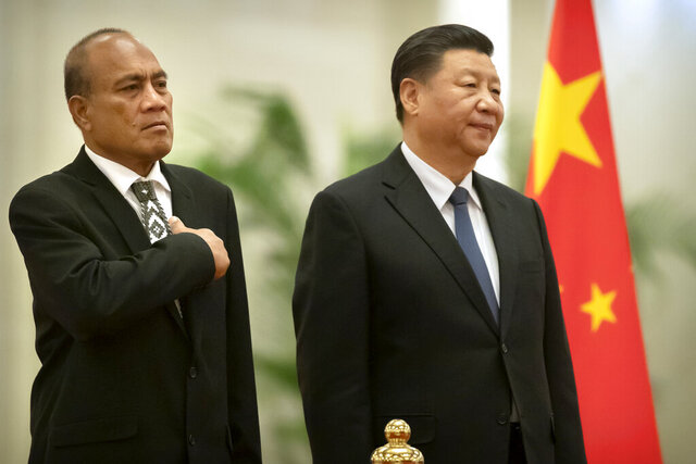 Kiribati's President Taneti Maamau, left, and Chinese President Xi Jinping stand together during a welcome ceremony at the Great Hall of the People in Beijing, Monday, Jan. 6, 2020. (AP Photo/Mark Schiefelbein)