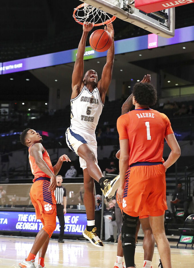 Georgia Tech forward Moses Wright dunks over Clemson forward Jonathan Baehre during the first half of an NCAA college basketball game Wednesday, Jan. 20, 2021, in Atlanta. (Curtis Compton/Atlanta Journal Constitution via AP, Pool)