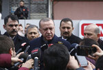 Turkey's President Recep Tayyip Erdogan speaks to the media as he visits the site of a collapsed building in Istanbul, Saturday, Feb. 9, 2019. Erdogan says there are