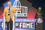 """FILE - In this Aug. 7, 2021, file photo, Paul Tagliabue, a former NFL commissioner and a member of the Pro Football Hall of Fame Centennial Class, speaks during the induction ceremony at the Pro Football Hall of Fame in Canton, Ohio. Tagliabue's new memoir """"Jersey City to America's Game,"""" sticks to his journey and lets the facts speak for him. It's a terrific ride, a look into the inner workings of the nation's most popular sport. (AP Photo/David Richard, File)"""