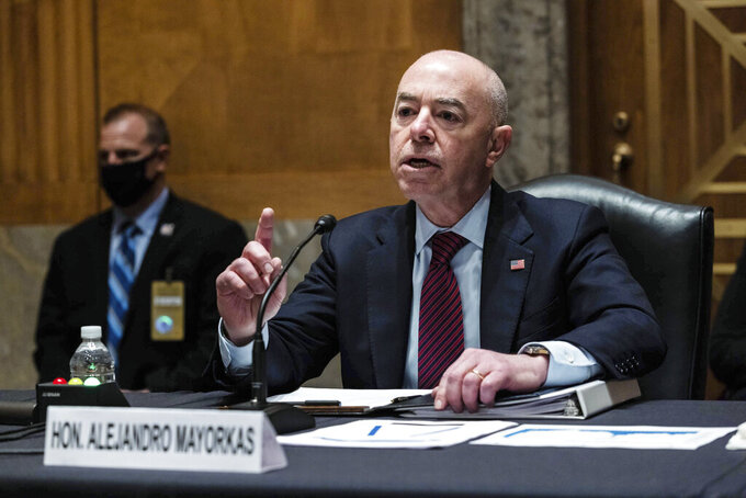 Homeland Security Secretary Alejandro Mayorkas testifies before a Senate Homeland Security and Government Affairs Committee hearing on Capitol Hill, in Washington, Thursday, May 13, 2021. (Graeme Jennings/Pool via AP)
