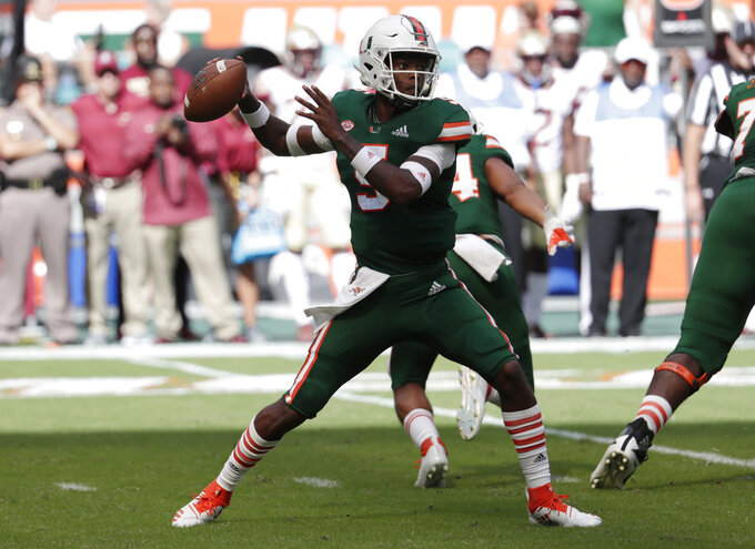 Miami quarterback N'Kosi Perry stands back to pass during the first half of an NCAA college football game against Florida State, Saturday, Oct. 6, 2018, in Miami Gardens, Fla. (AP Photo/Lynne Sladky)