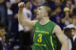 Oregon guard Payton Pritchard (3), reacts after he made the game-winning 3-point basket in overtime of an NCAA college basketball game against Washington, Saturday, Jan. 18, 2020, in Seattle. Oregon won 64-61 in overtime. (AP Photo/Ted S. Warren)