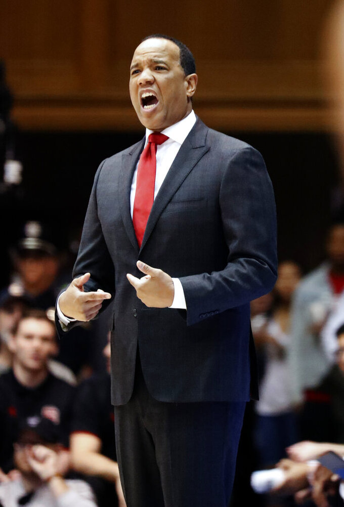 North Carolina State head coach Kevin Keatts directs the team during the first half of an NCAA college basketball game against Duke in Durham, N.C., Saturday, Feb. 16, 2019. (AP Photo/Chris Seward)