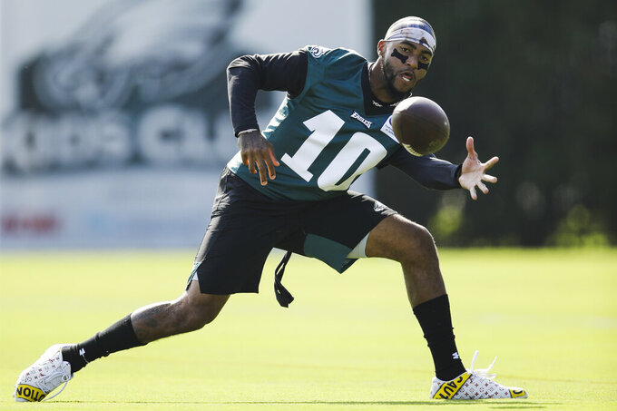 FILE - In this July 26, 2019, file photo, Philadelphia Eagles wide receiver DeSean Jackson catches a pass during practice at the NFL football team's training camp in Philadelphia. Jackson joining Alshon Jeffrey and Nelson Agholor gives the team a deep threat who will open the field underneath for everyone else. (AP Photo/Matt Rourke, File)