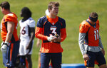 His right hand wrapped because of a thumb injury, Denver Broncos rookie quarterback Drew Lock looks on as teammates take part in an NFL football practice Tuesday, Aug. 27, 2019, at the team's headquarters in Englewood, Colo. (AP Photo/David Zalubowski)