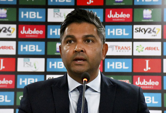Pakistan's Cricket Board managing director Wasim Khan gives a news conference, in Karachi, Pakistan, Thursday, March 4, 2021. The Pakistan Super League has been postponed indefinitely after six players and a support staffer tested positive for COVID-19, the Pakistan Cricket Board said Thursday. (AP Photo/Fareed Khan)
