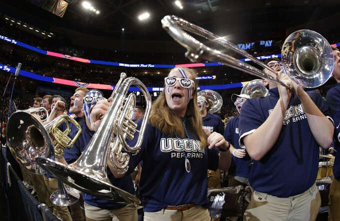 The Connecticut band performs during the first half of the team's Final Four semifinal against Notre Dame in the NCAA women's college basketball Friday, April 5, 2019, in Tampa, Fla. (AP Photo/Chris O'Meara)