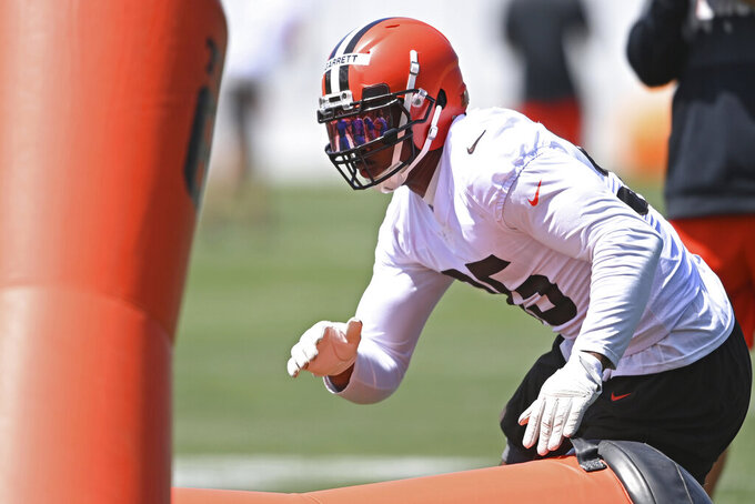 Cleveland Browns defensive lineman Myles Garrett (95) participates in a drill during an NFL football practice at the team training facility, Tuesday, June 15, 2021 in Berea, Ohio. (AP Photo/David Dermer)