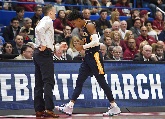 Murray State's Ja Morant, right, reacts as he walks toward Murray State's head coach Matt McMahon during the first half of a second round men's college basketball game against Florida State in the NCAA tournament, Saturday, March 23, 2019, in Hartford, Conn. (AP Photo/Jessica Hill)