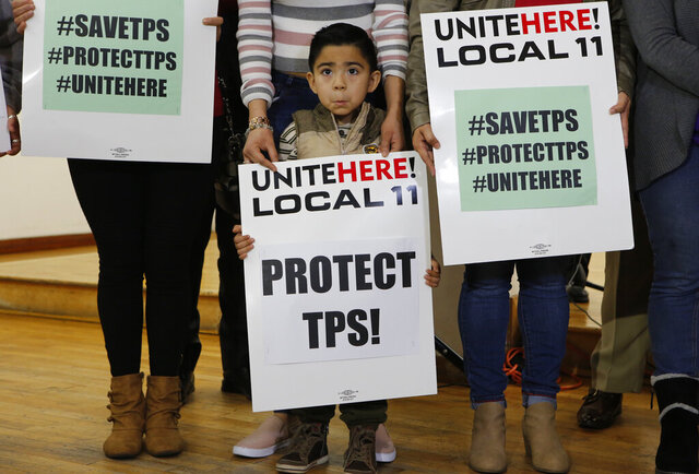 FILE - In this Jan. 8, 2018, file photo, Mateo Barrera, 4, originally from El Salvador, whose family members benefit from Temporary Protected Status attends a news conference in Los Angeles. The Trump administration can end humanitarian protections that have allowed hundreds of thousands of people from El Salvador, Nicaragua, Haiti and Sudan to remain in the United States, a divided appeals court ruled Monday, Sept. 14, 2020. The 9th U.S. Circuit Court of Appeals lifted a preliminary injunction that had blocked the government from ending Temporary Protected Status, or TPS, for people from those four countries. People from El Salvador would be most affected. (AP Photo/Damian Dovarganes, File)