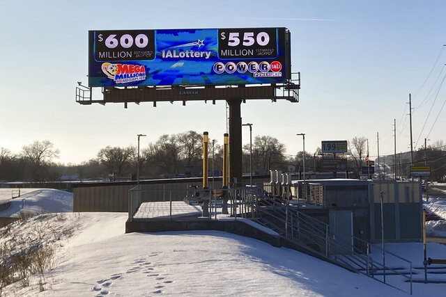 A digital billboard in Des Moines, Iowa, on Monday, Jan. 11, 2021, shows jackpots for the Mega Millions and Powerball games. Lottery players have a chance to win the largest jackpots in nearly two years as Mega Millions has grown to $600 million and Powerball has climbed to $550 million. (AP Photo by Scott McFetridge)