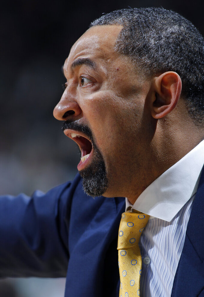 Michigan coach Juwan Howard reacts during the second half of an NCAA college basketball game against Michigan State, Sunday, Jan. 5, 2020, in East Lansing, Mich. (AP Photo/Al Goldis)