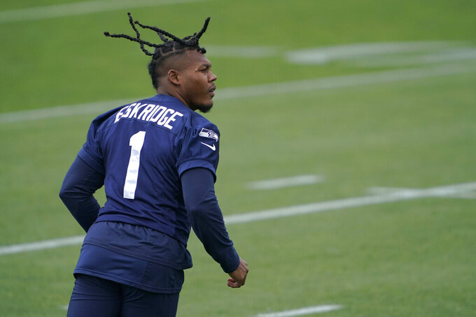 Seattle Seahawks wide receiver D'Wayne Eskridge tracks a pass as he runs a drill during NFL football practice Tuesday, June 15, 2021, in Renton, Wash. (AP Photo/Ted S. Warren)