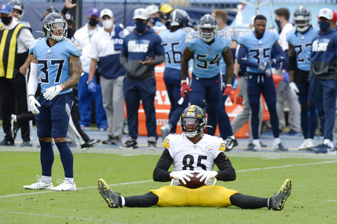 Pittsburgh Steelers tight end Eric Ebron (85) sits on the ground after catching a pass against the Tennessee Titans in the first half of an NFL football game Sunday, Oct. 25, 2020, in Nashville, Tenn. (AP Photo/Mark Zaleski)