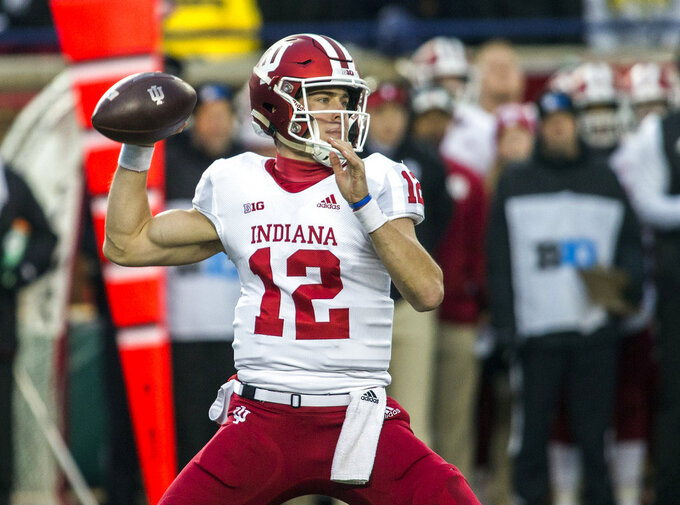 Indiana quarterback Peyton Ramsey (12) throws a pass in the first quarter of an NCAA college football game against Michigan in Ann Arbor, Mich., Saturday, Nov. 17, 2018. (AP Photo/Tony Ding)